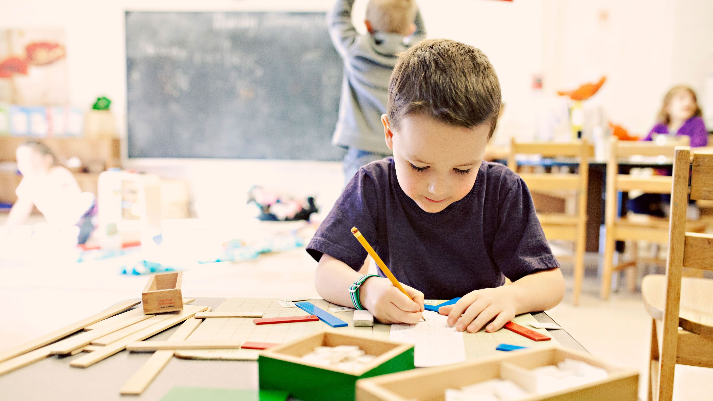 young boy in school working alone