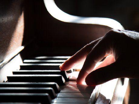 Hand on keys of a piano