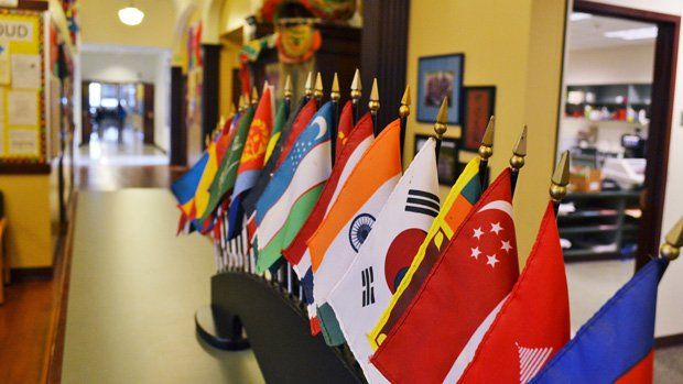 Flags from around the World lining a school hallway