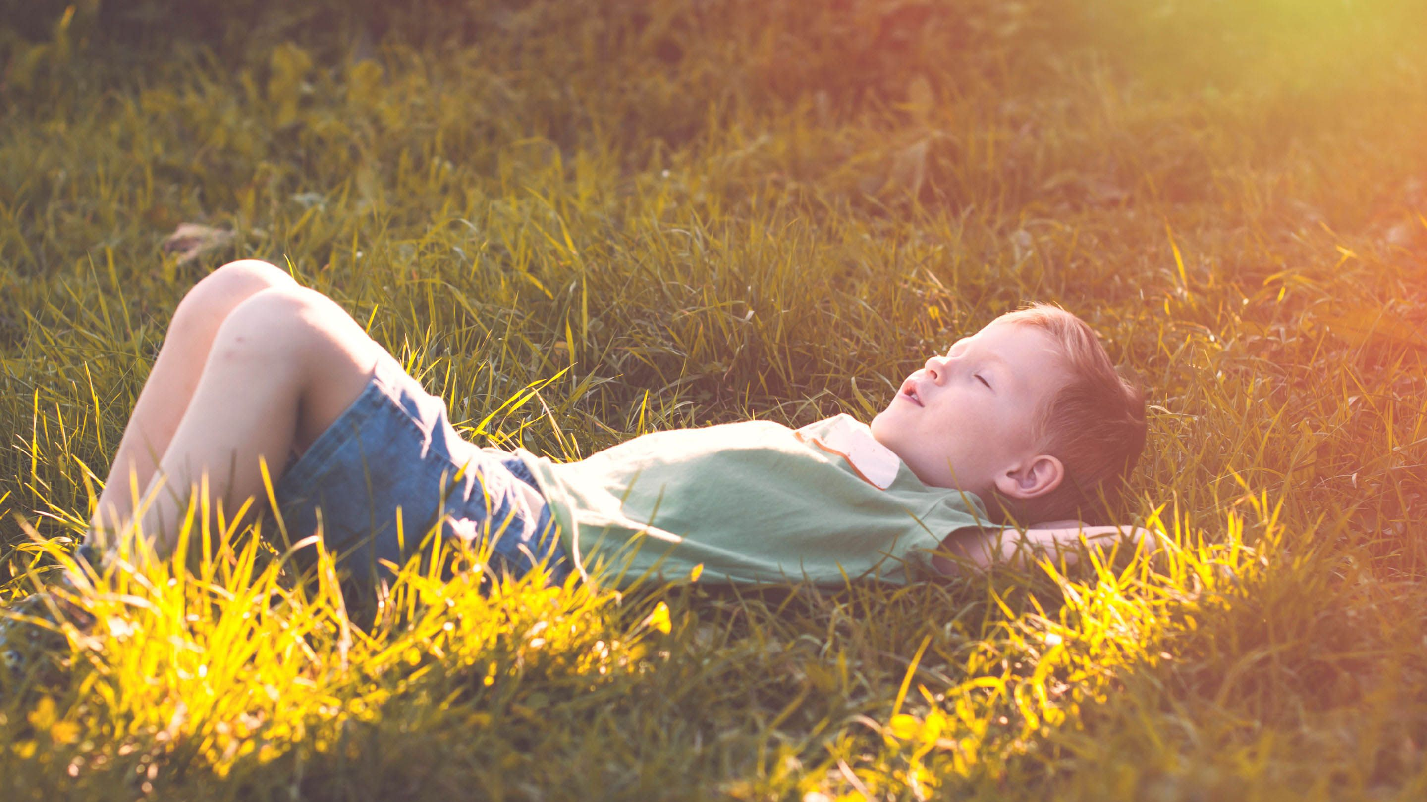photo of a student in the grass