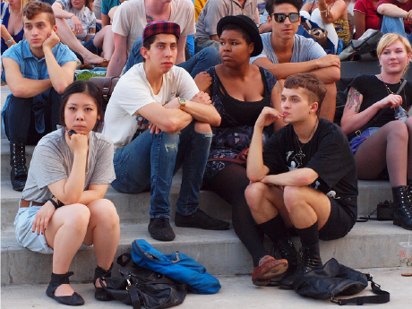 A photo of a group of teens hanging out.