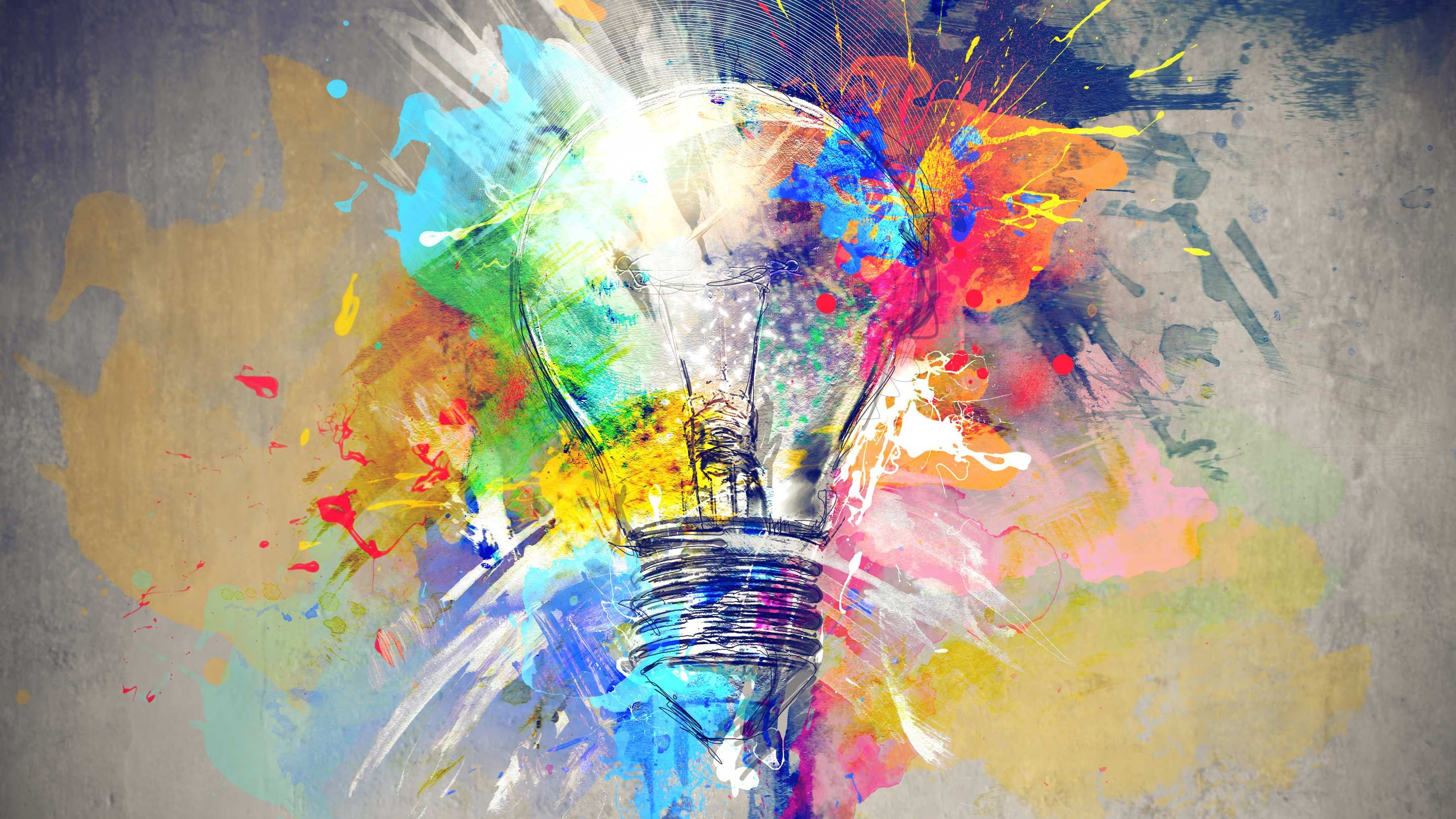 Illustration of a light bulb with splashes of bright paint, representing the flash of creativity