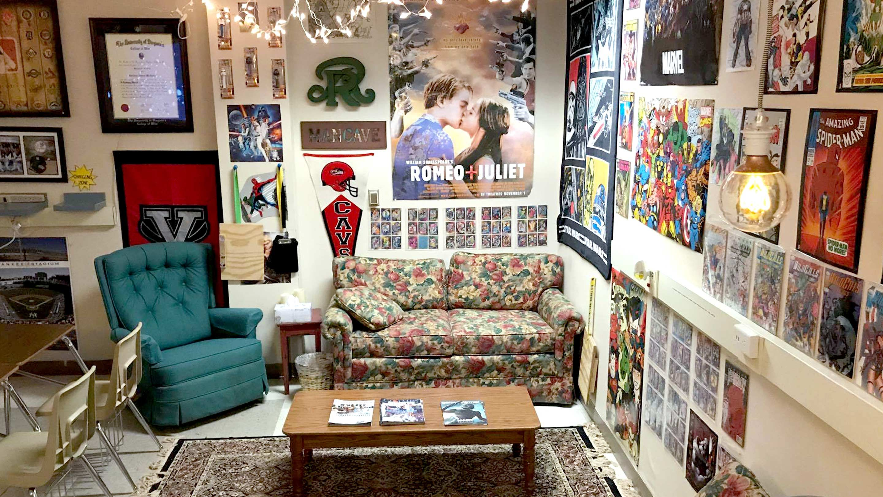A classroom nook with a couch, armchair, and coffee table