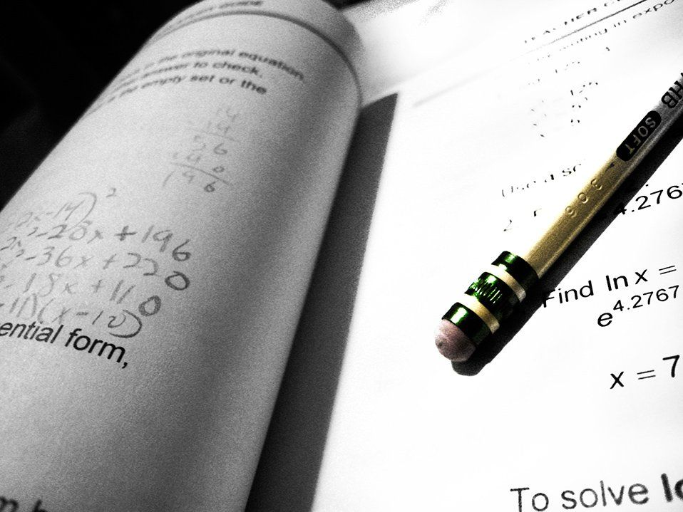 Pencil laying in a math workbook