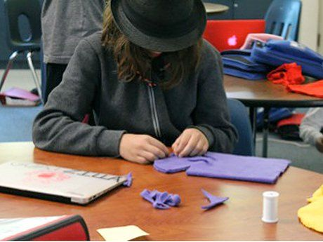 Student working on a puppet