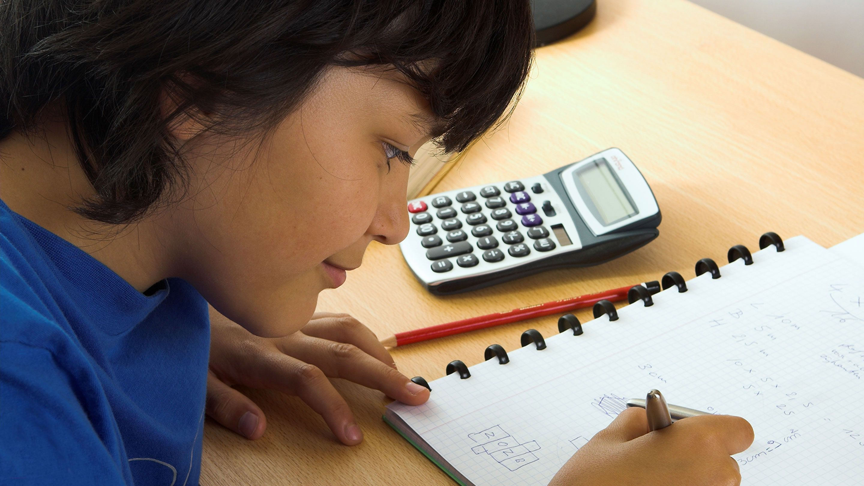 A boy works on a math problem.