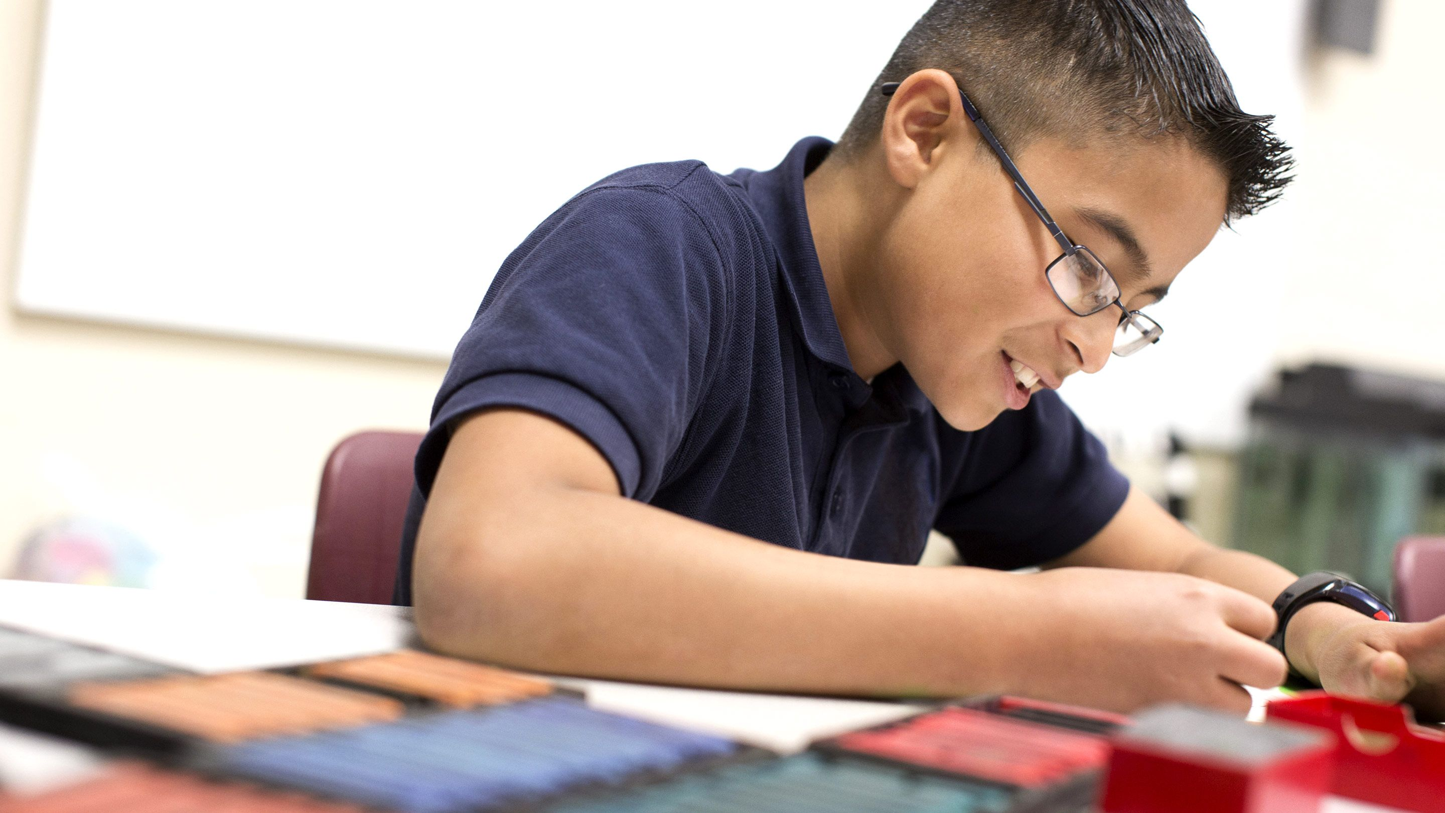 A student at work in class on a project of his choosing