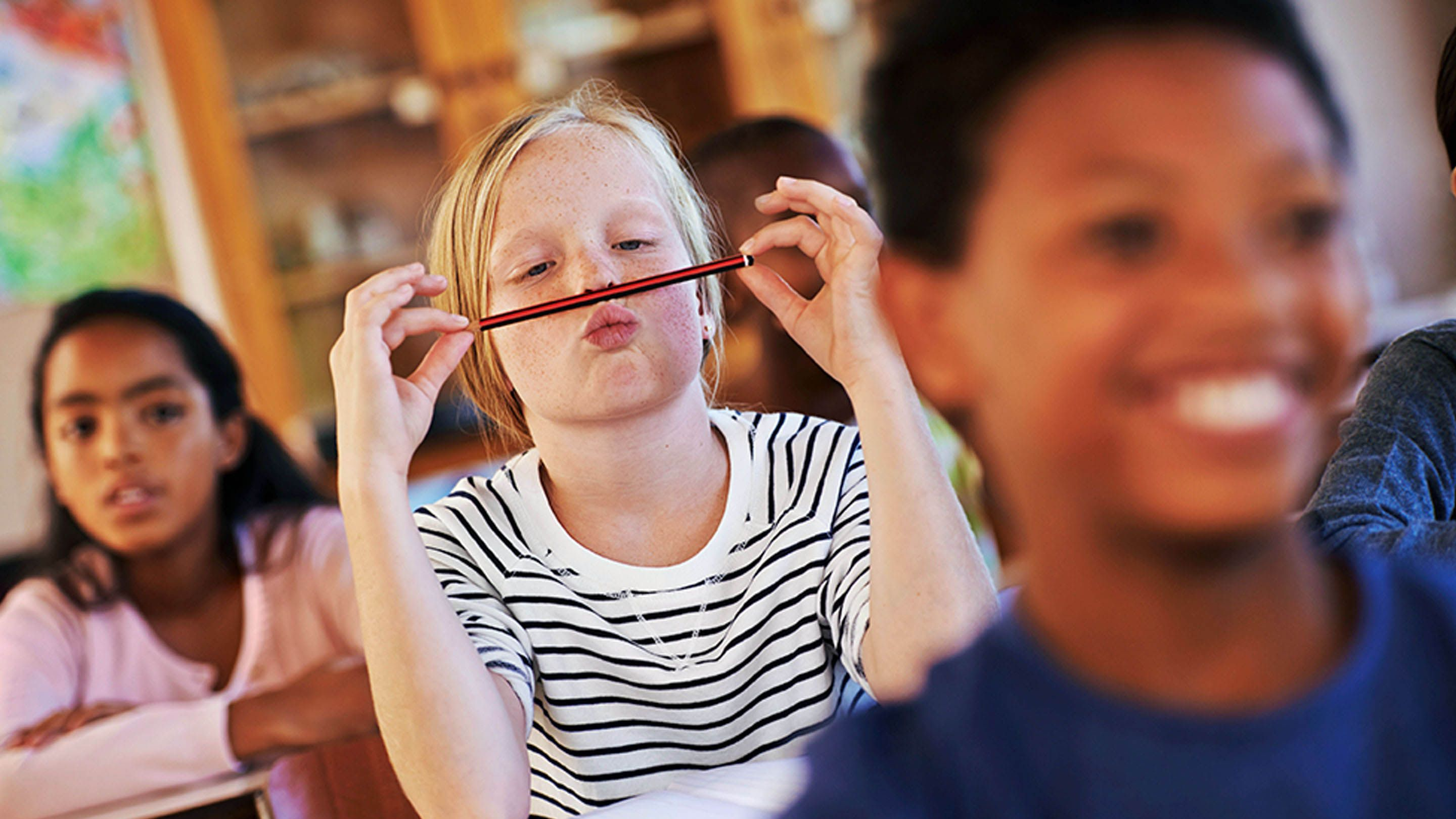 photo of a student balancing a pencil under his nose