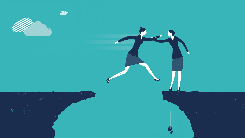 A teacher helps another teacher cross a chasm