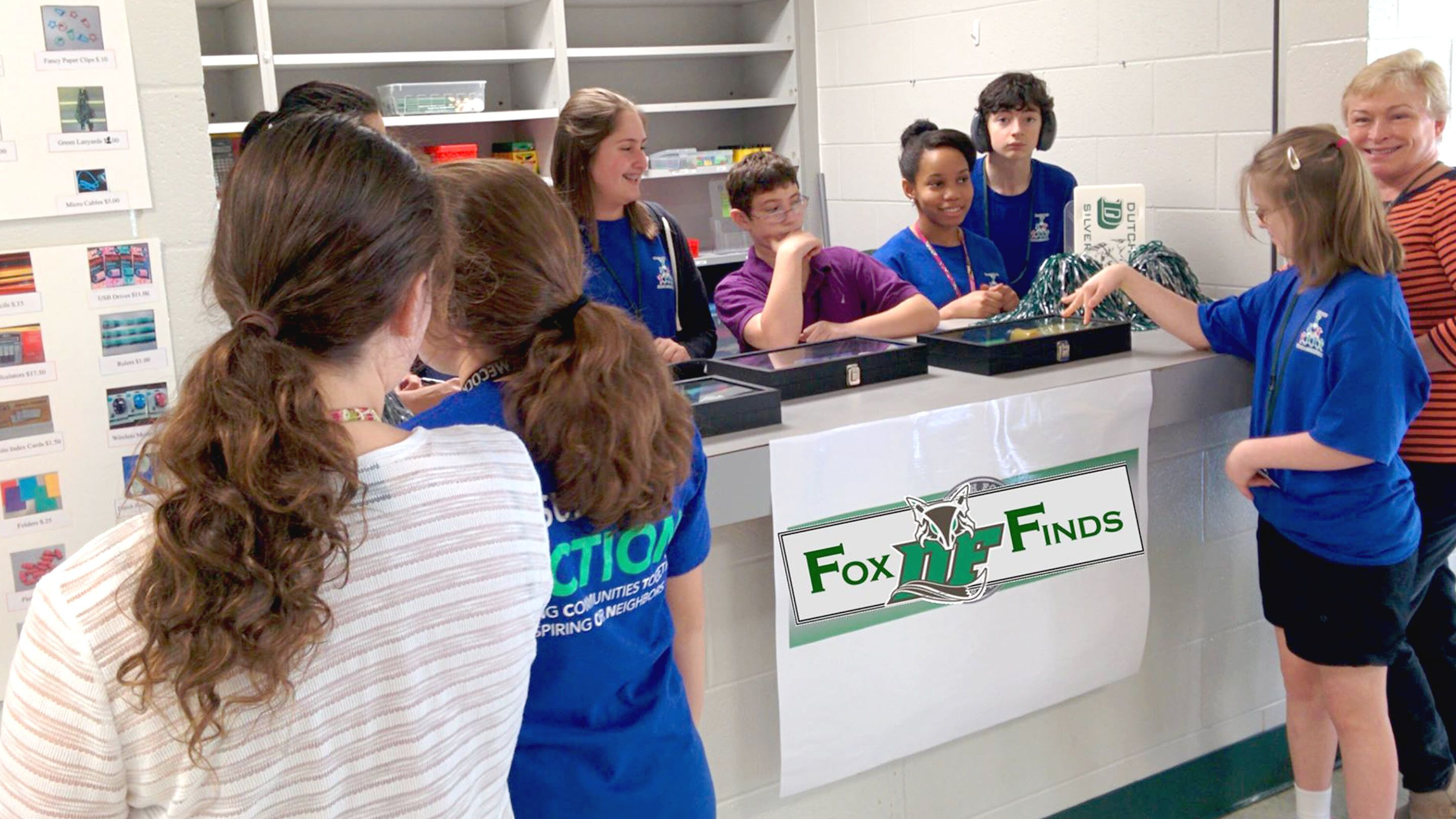 A team of students manages a school store together.