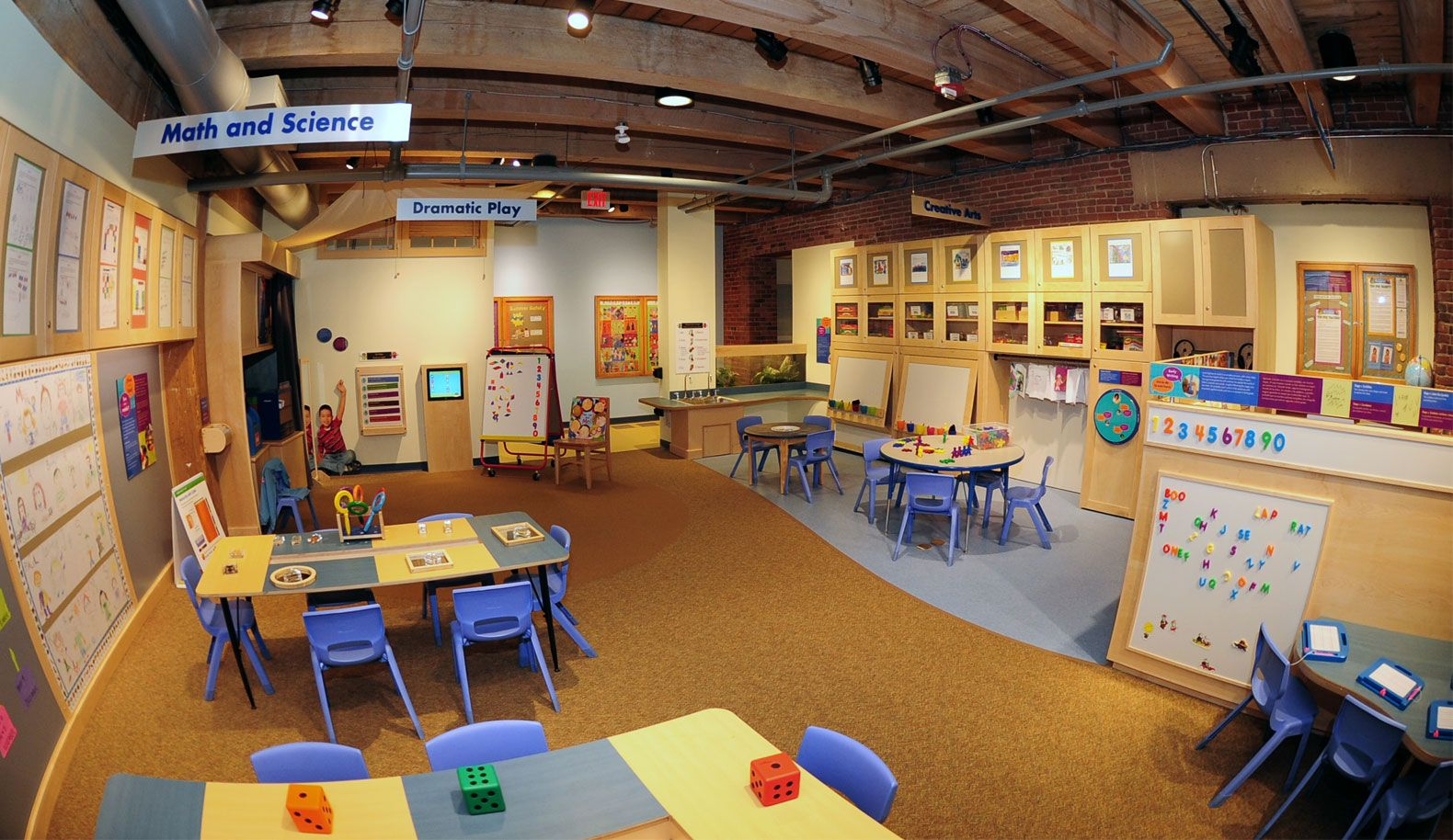 The kindergarten exhibit at the Boston Children's Museum features typical stations you'd find in a kindergarten classroom.