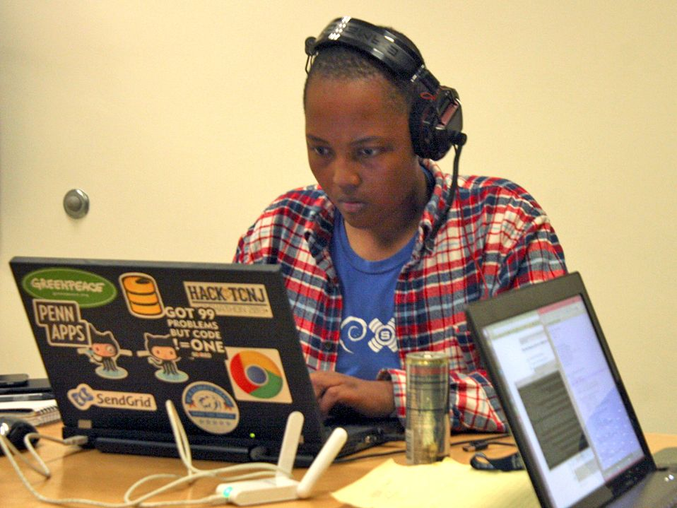 photo of a student coding on a laptop