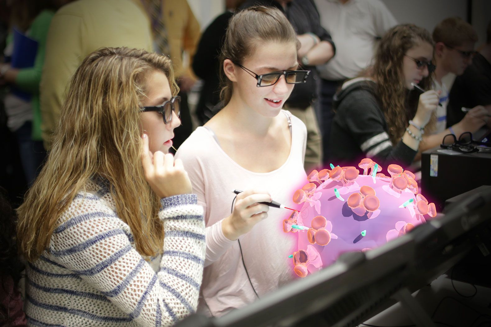 Students explore a virus using zSpace computers and glasses that allow objects to pop out of a flat screen in 3D.