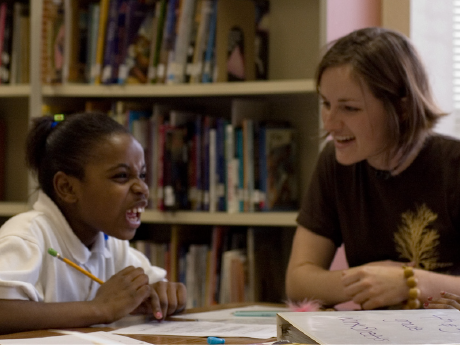 photo of a student and teacher sharing a laugh