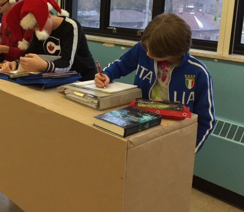 Students using a finished stand up table