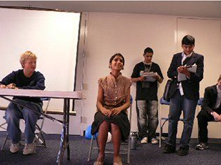 High school students presenting a mock court hearing