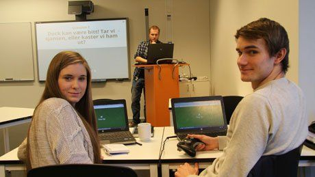 Tobias Staaby and two students