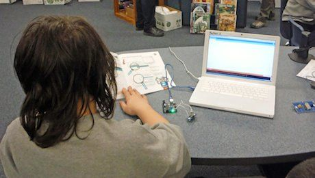 Sparks Middle School student learning how to program Arduinos.