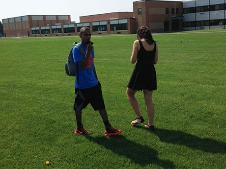 Batavia High School students use smartphones for note taking during an outdoor class segment.
