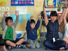 Morning yoga in class teaches kids to breathe.