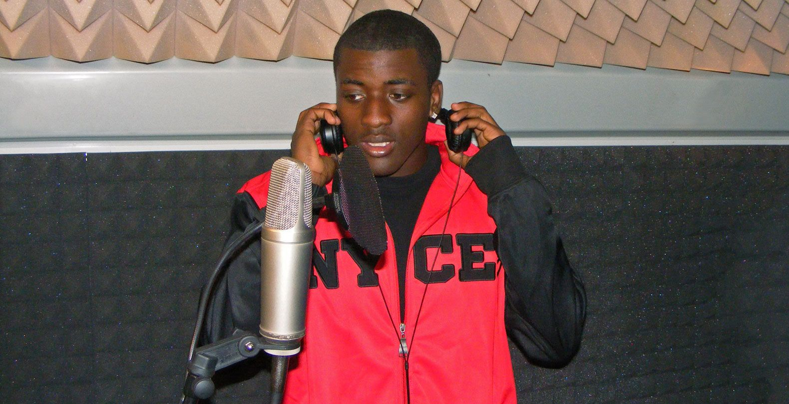 Youths in Charleston create music tracks in a mobile recording studio.