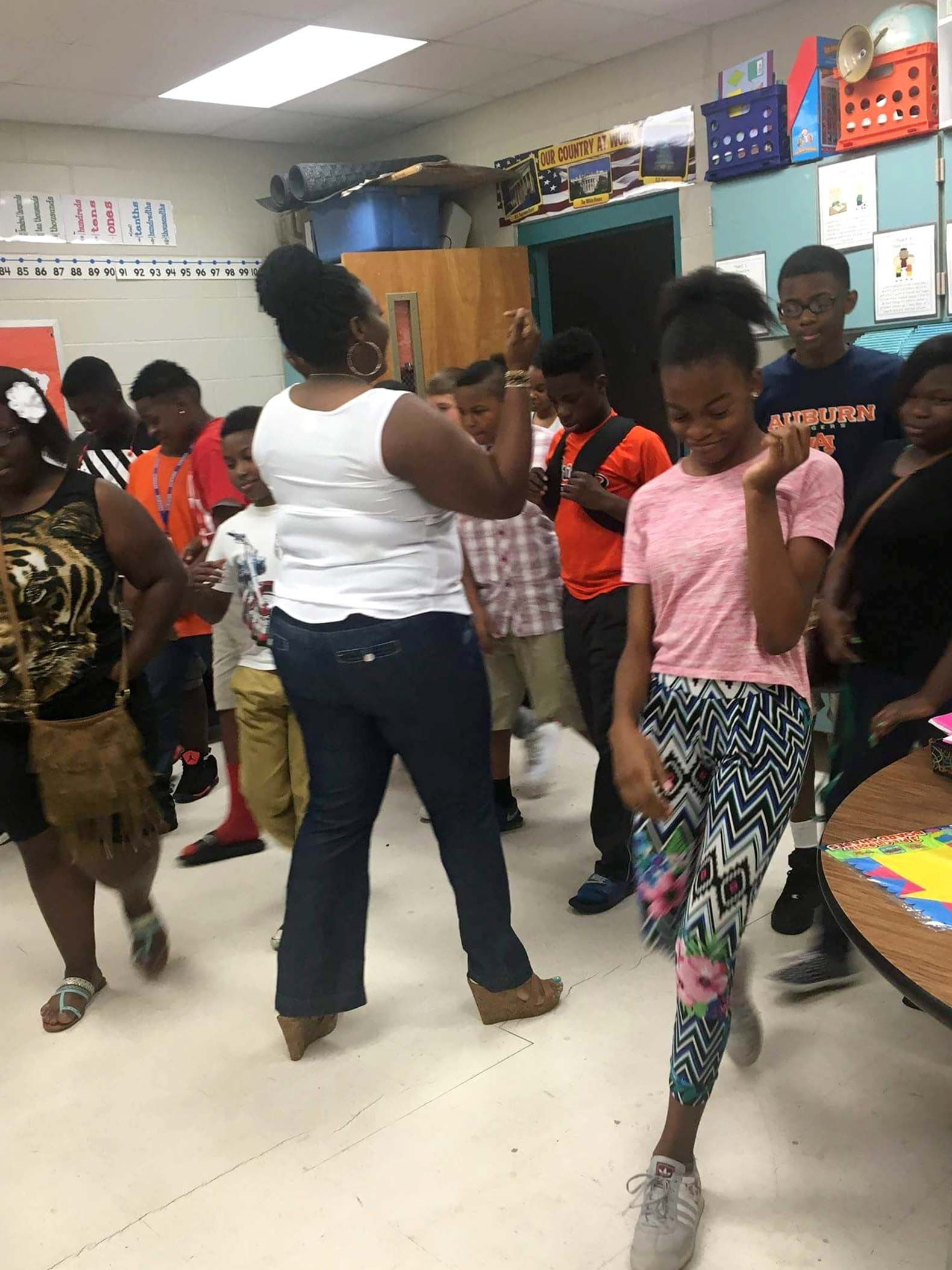 Sandreka Brown dances with her students. The Georgia-based teacher received her board certification last year.