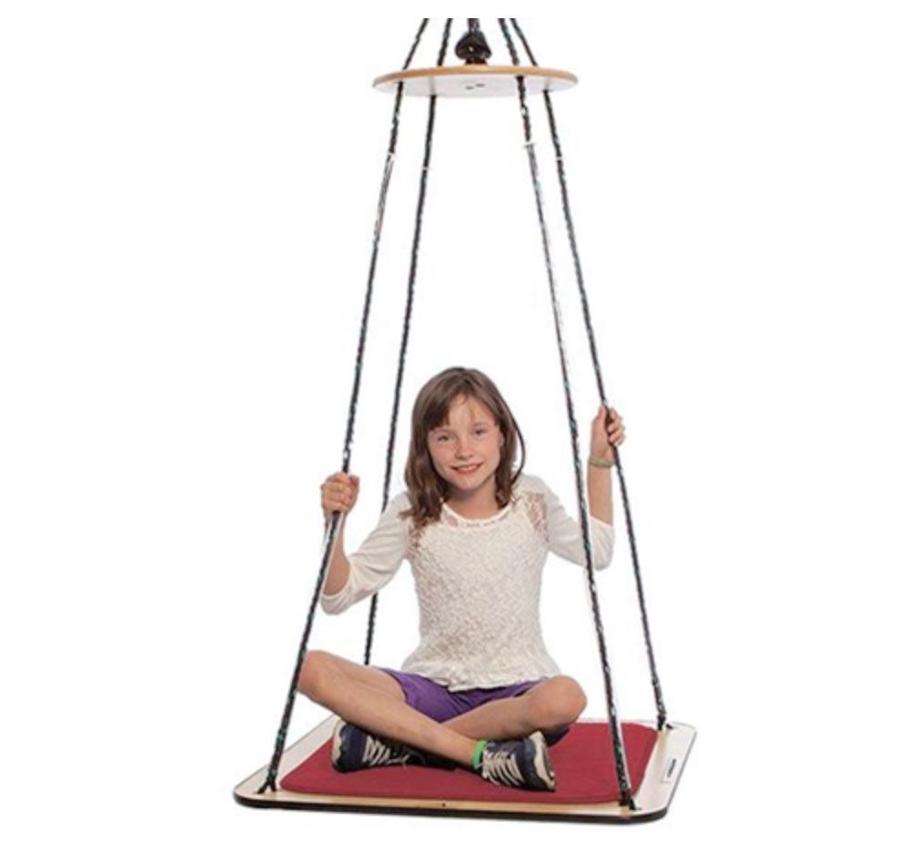 Platform swings like this one provide students with vestibular input that helps improve their sense of balance.