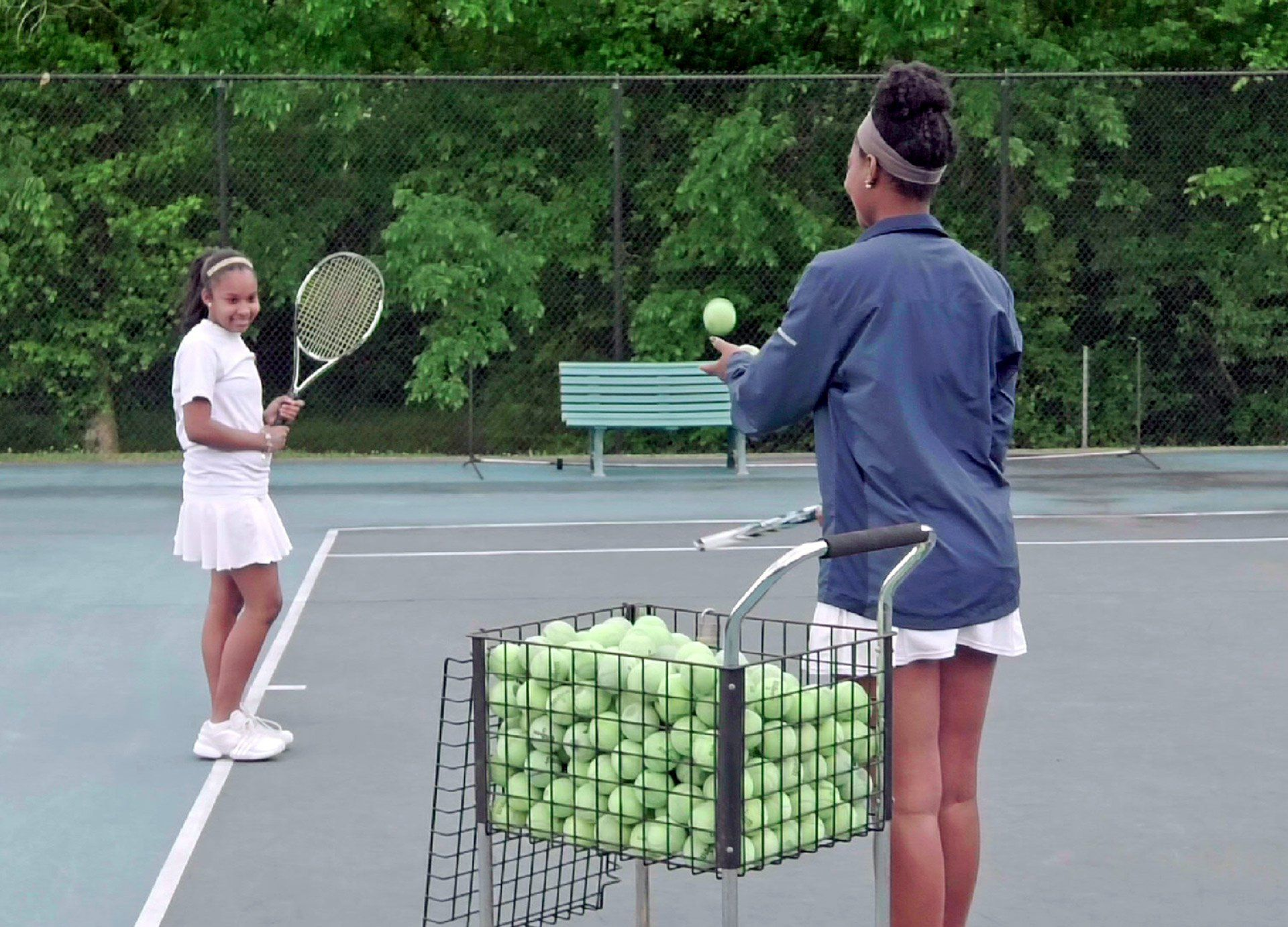 Andi and Ashanti during a tennis lesson