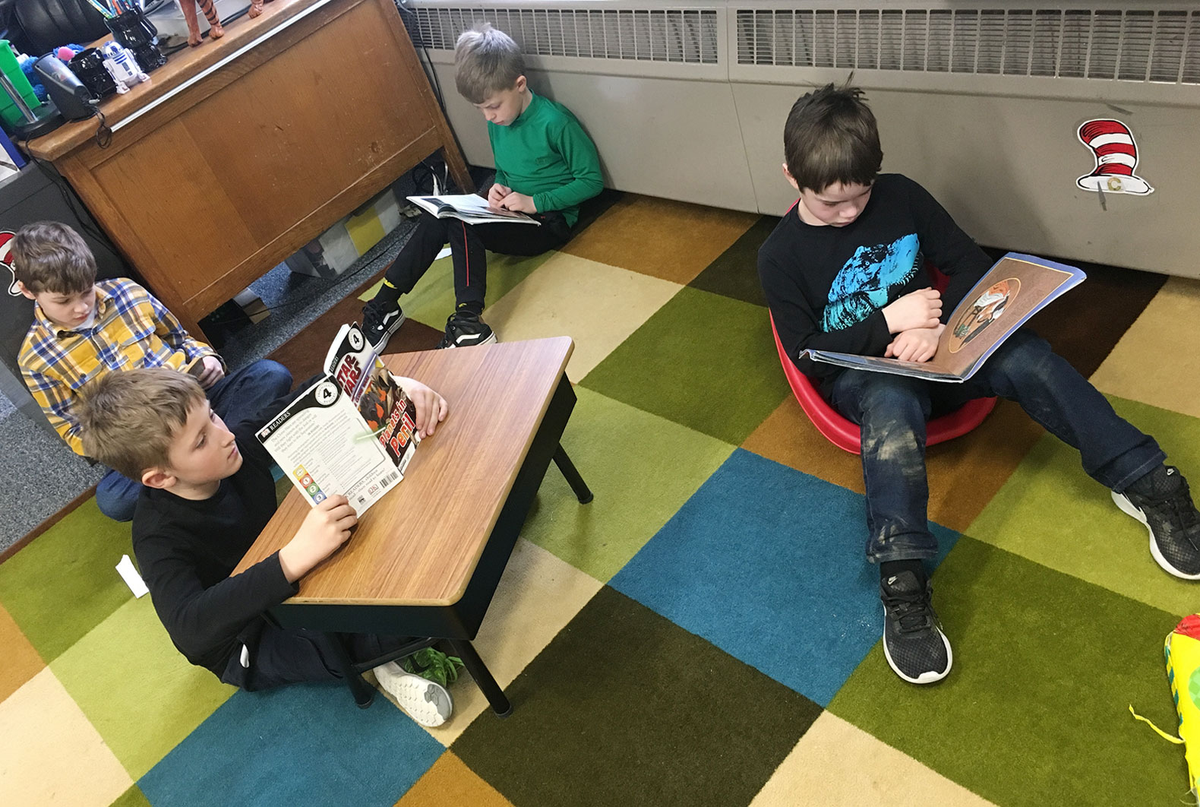 Flexible seating in the author's classroom. The boy at right is using a gaming rocker.