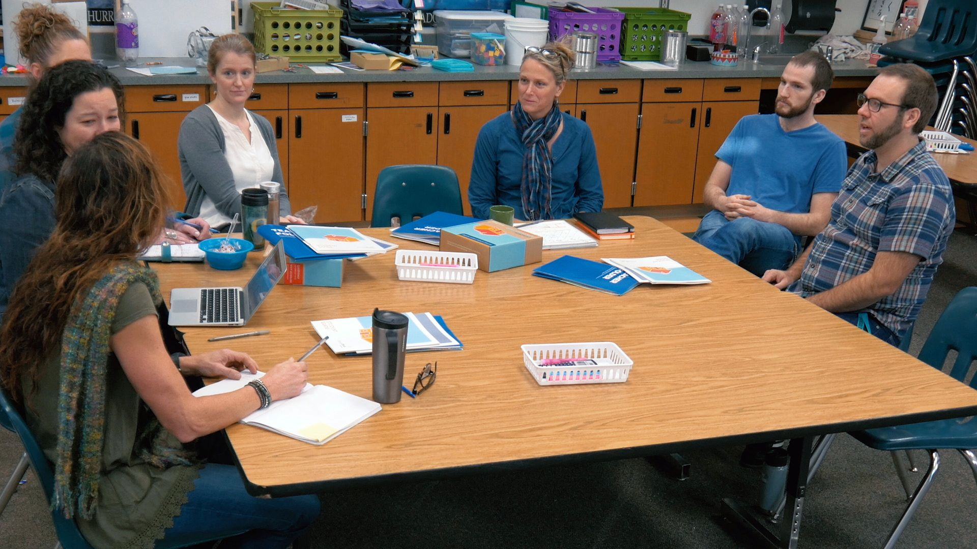A group of teachers are having a meeting.