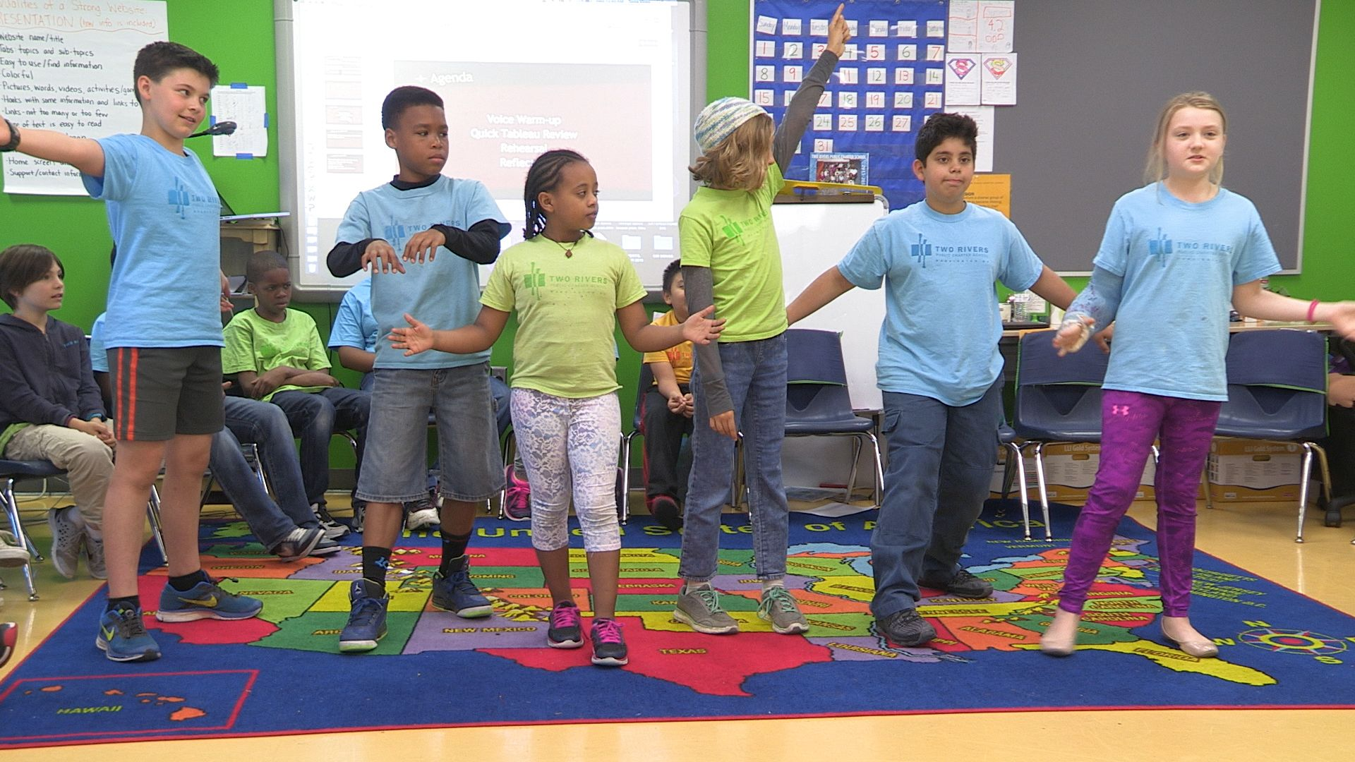 A group of students are having fun in a classroom.