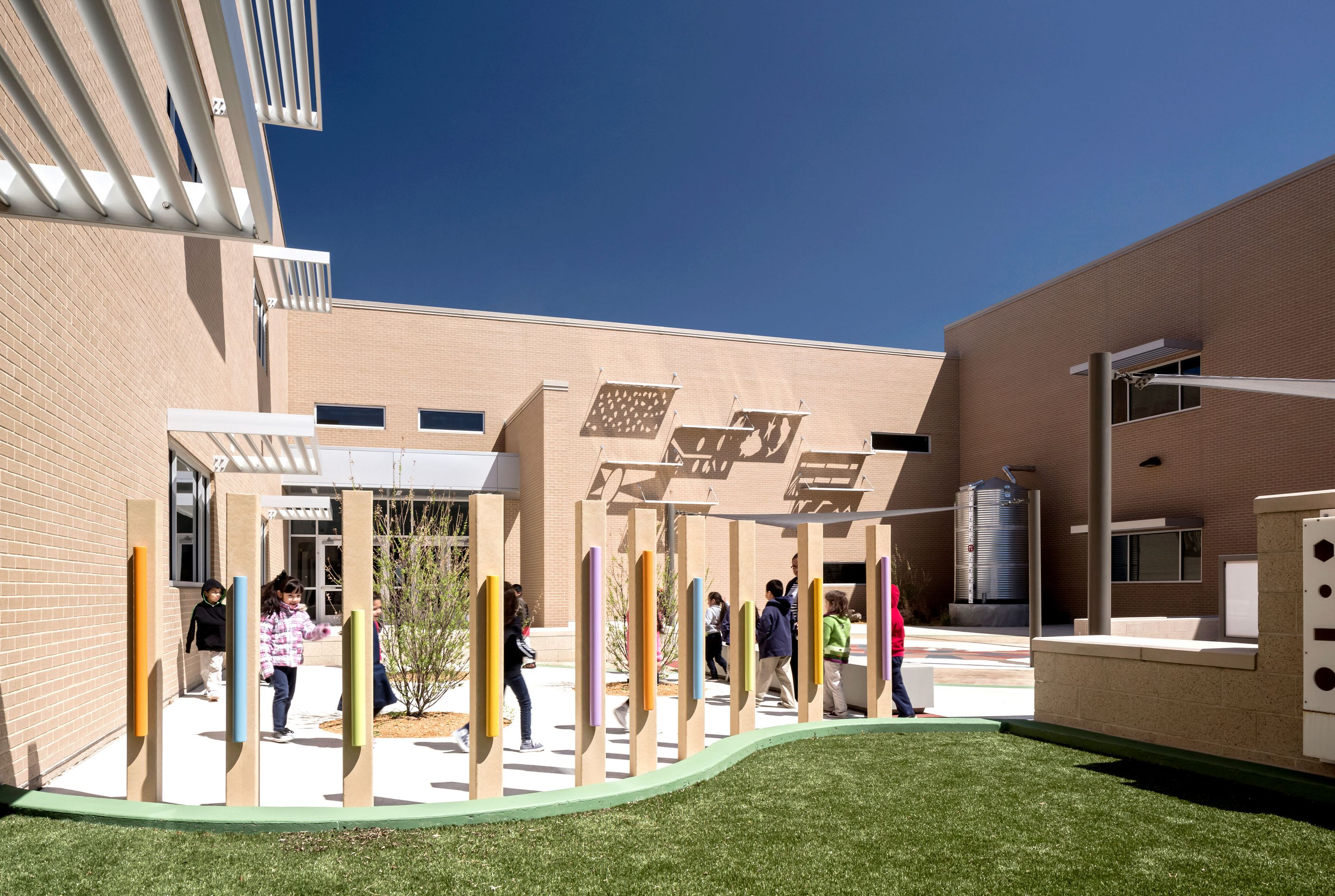 Daugherty Elementary School has a variety of outdoor learning zones connected to Texas standards. The shadow wall in the courtyard teaches students about the earth's rotation.