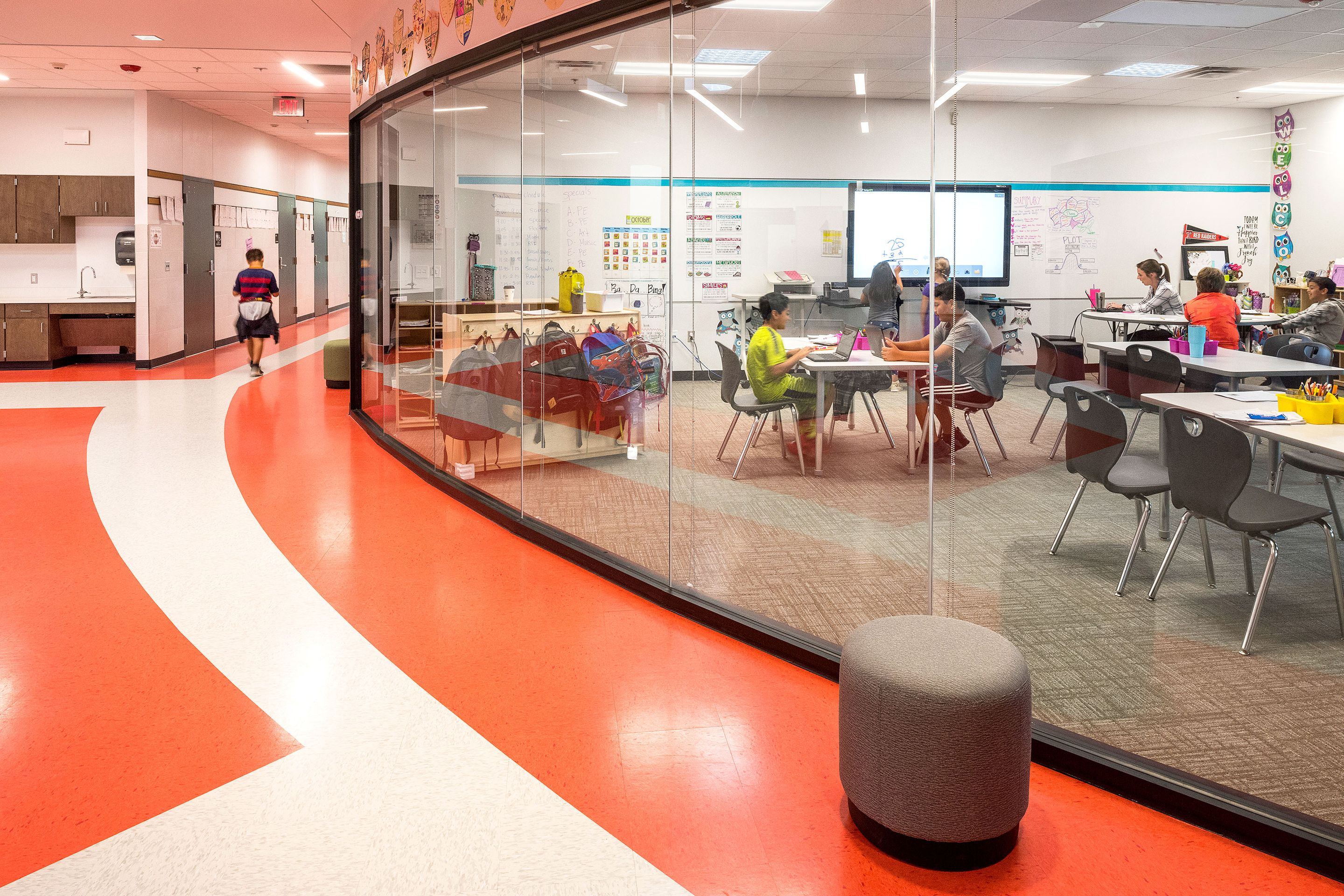 Each classroom at Annie Purl Elementary School features floor-to-ceiling glass walls to create an open and transparent environment.