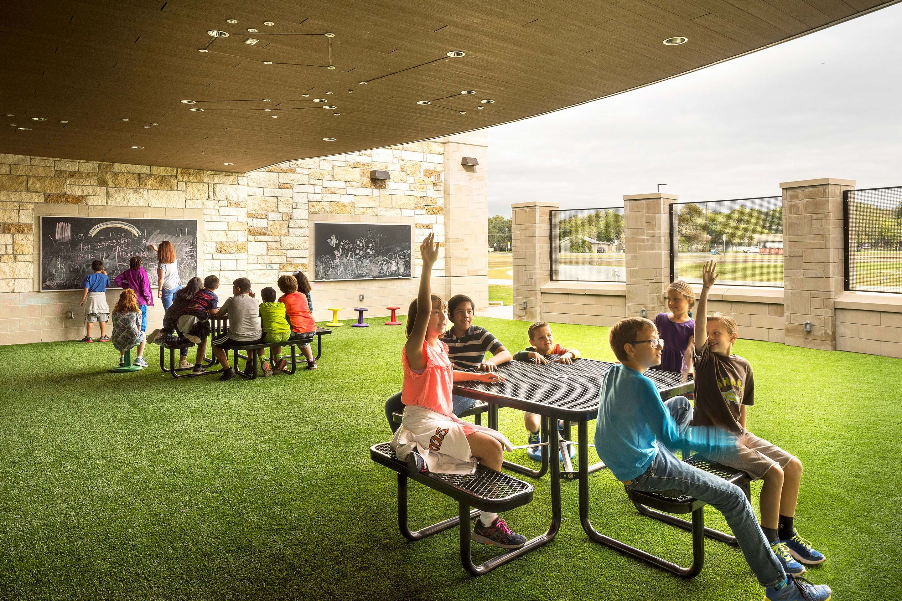 At Annie Purl Elementary School, a public school in Georgetown, Texas, the outdoor classroom is a multipurpose space used for play, instruction, making, science experiments, and collaborative activities.