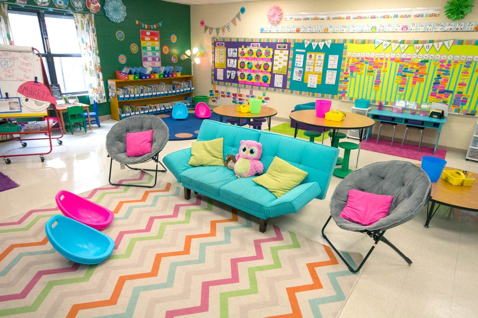 Broomfield's room offers a variety of seating options, from a couch to scoop chairs to wobble stools.
