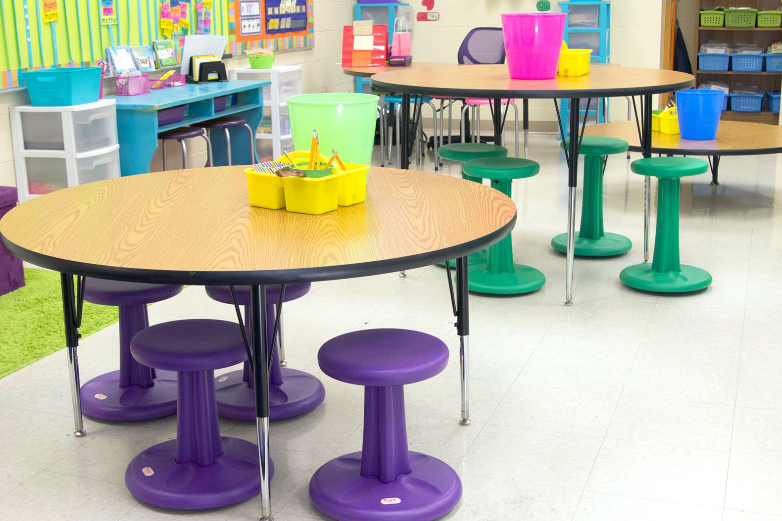 First-grade teacher Ashley Rice Broomfield uses different table heights to cater to her students' preferences.