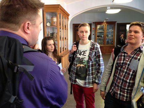 PennFinn13 team members speak with students between classes