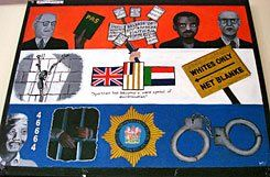 Symbols of Change:  A painting by a student at the Herschel Girls' School depicts apartheid laws, the treatment of political prisoners, and Nelson Mandela.