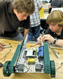 Newcomers to the robotics elective learn the basics of building an axle.