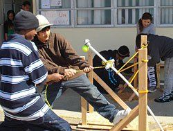 Launch Lessons:  Ninth-grade algebra students Dontae and Gerry built catapults to test the quadratic equation in real life.