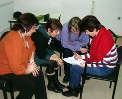 Group Huddle:  Educators in a teacher-training workshop collaborate on an assignment.