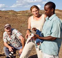Writing Around the World:  Archaeologist Louise Leakey (middle), Lourie (left), and a field assistant (right) study global-positioning-system coordinates for fossil finds in Lake Turkana, Kenya, in 2007.