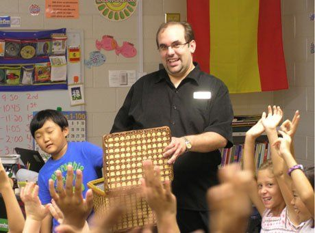 Spanish teacher Joe Uriz engages students' senses with a mystery box activity.