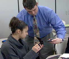 "Handhelds Go to Class: Teacher Josh Barron and one of his students go through the strange-looking rite of ""beaming"" information to each other."