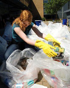 Landfill Diversion: A student retrieves recyclable material that was tossed in the garbage.