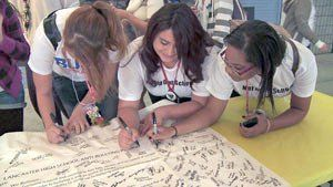 Students at Lancaster High School sign a pledge to end school bullying.