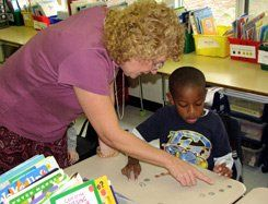 Show Me the Money: Teacher Eileen Sheehan helps a student count his coins.