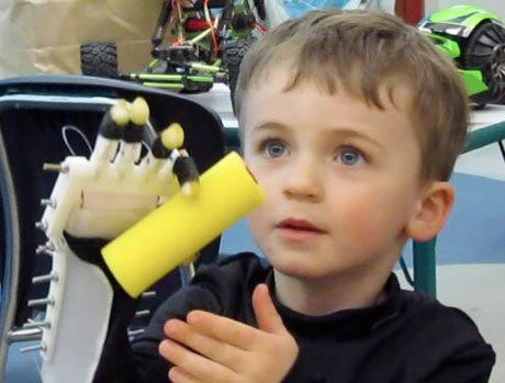 Max tries out his mechanical Robohand.