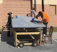 Smooth Operators:  Team members hone the solar car's mold.