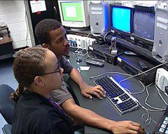 Students at an editing station match music to images in a tribute to the firemen of 9/11.
